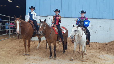 Image: Ellis County Silver Spurs riders swept Horsemanship! From left, Brylee Tucker of Hillsboro 3rd place, Gentry Rogers of Milford 2nd place, and Sadie Hinz of Italy 1st place.
