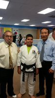 Image: Pictured is Master Charles Kight chief instructor of the school, Nick and Grand Master BK Park co-founder of Unified Tae Kwon Do School.