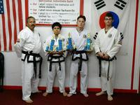 Image: Pictured Roger Sam, Instructor, Nick Sam, 2nd Degree Black Belt, Michael Bryant, 1st Degree Black Belt and Travis Tinney Instructor