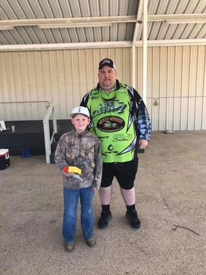 Image: Most fish caught and 3rd place junior Garrett Lennon with sponsor Kevin Janes from Line Cutterz